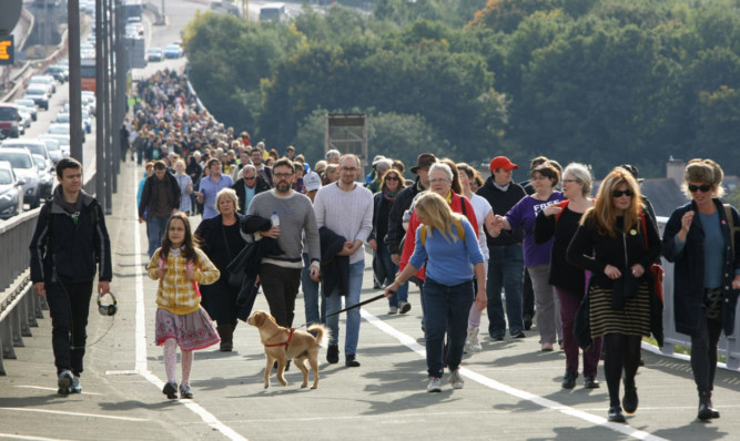Police say about 600 people attended the Hands Across the Forth event.
