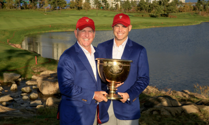 Team USA captain Jay Haas and son Bill Haas with the Presidents Cup.