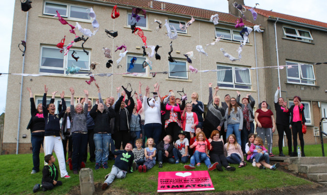 Talk of the town: residents under the chain with some of the donated bras.