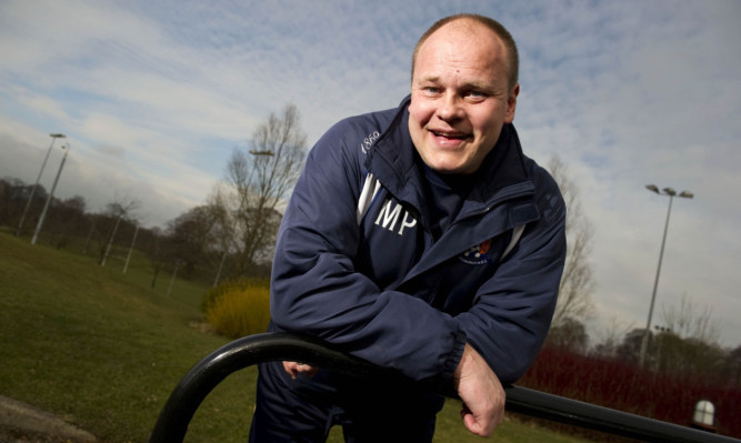 03/03/11  GARSCUBE - GLASGOW All smiles from Kilmarnock manager Mixu Paatelainen as he looks ahead to his side's weekend SPL clash with Hearts