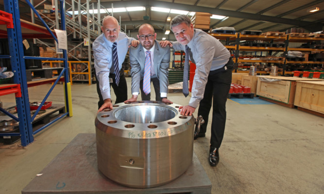 From left: Pacson managing director Keith Crawford, Clydesdale Banks Andy Tait and Pacson commercial director John McLaren.
