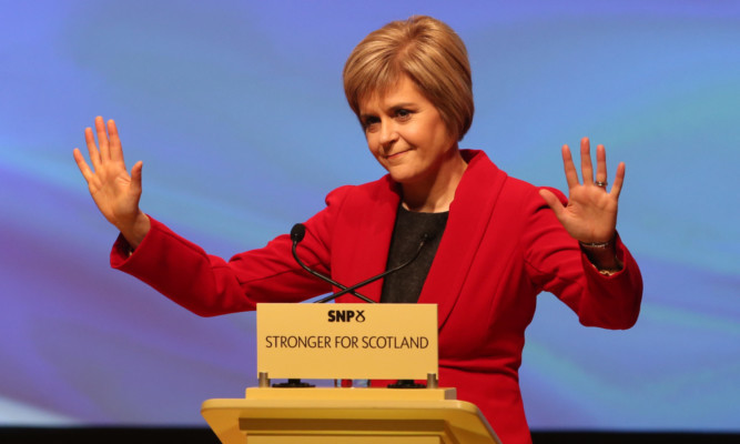 Nicola Sturgeon takes the acclaim at her first party conference as SNP leader.