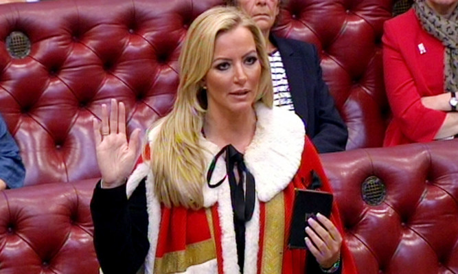 Entrepreneur Michelle Mone is admiited to the House of Lords as Baroness Mone of Mayfair, after being made a Tory peer.