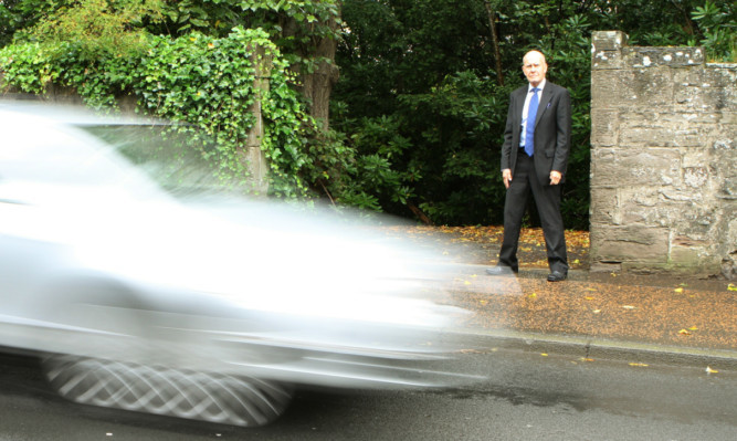 Councillor Willie Wilson at the point where the path meets Glasgow Road.