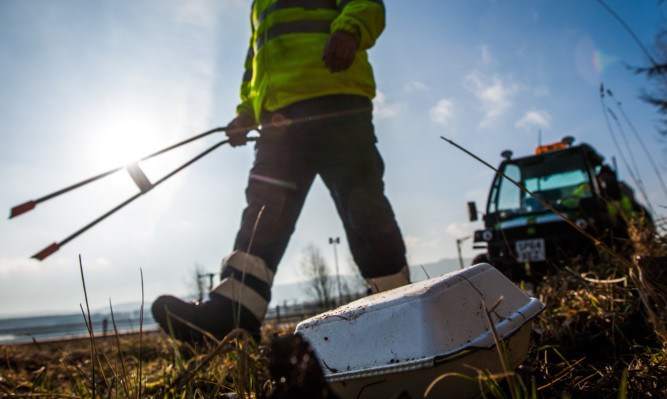 Litter pickers work on the A9.