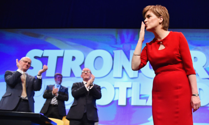 Nicola Sturgeon acknowledges the applause after her speech to the SNP conference in Aberdeen.