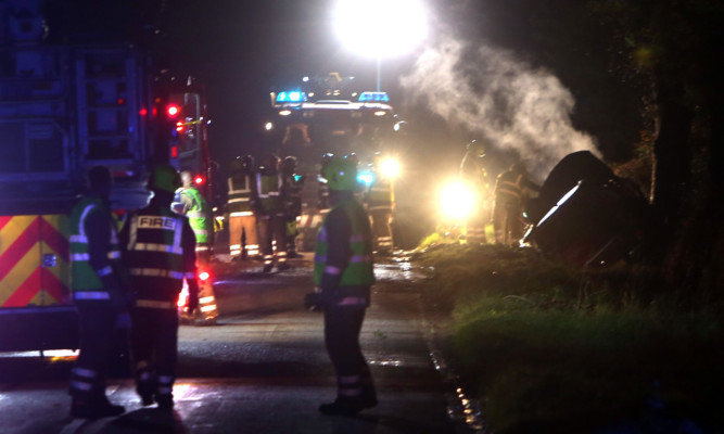 Brian Brown helped rescue a woman from a blazing car after the collision near Guildtown.