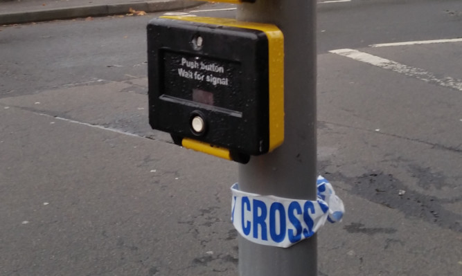 The remains of police tape at the crossing.