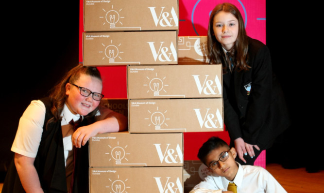 Pupils Rachel Glen, Lucy Bertie and Uwais Din with some of the packs.