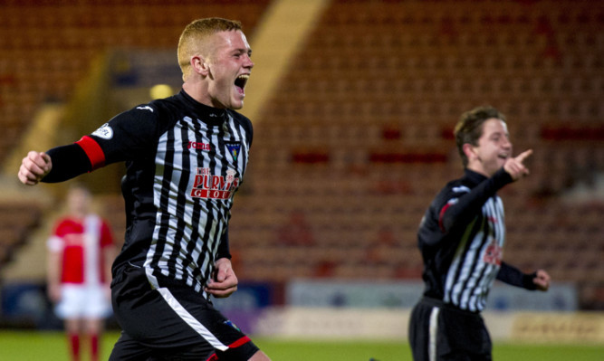 Dunfermline's Ryan Thomson (left) rushes to celebrate his winning goal.