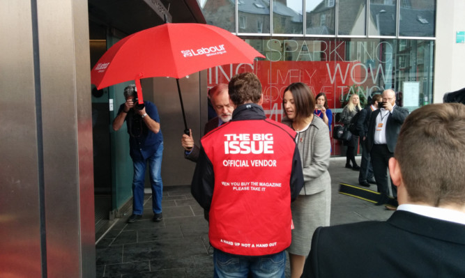 Jeremy Corbyn stopped in front of the cameras and party faithful to buy a copy of the Big Issue from a vendor - who had no clue who he was.