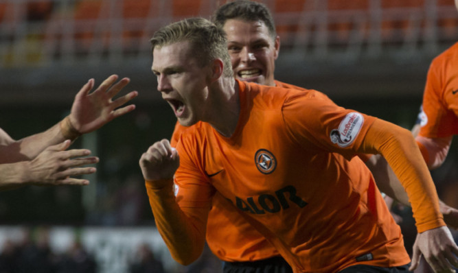 Billy Mckay celebrates scoring the winning penalty.