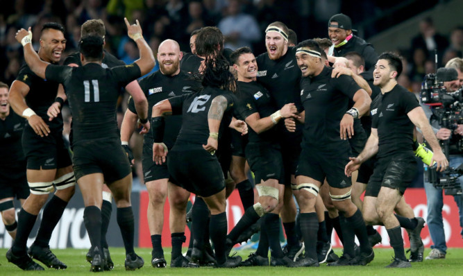 New Zealand players celebrate victory after the 2015 Rugby World Cup Final match against Australia at Twickenham.
