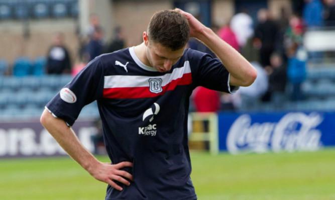 Despair at full-time on Sunday for Lewis Toshney.