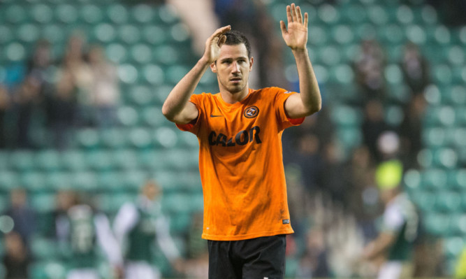 Ryan McGowan applauds the United support at Easter Road.
