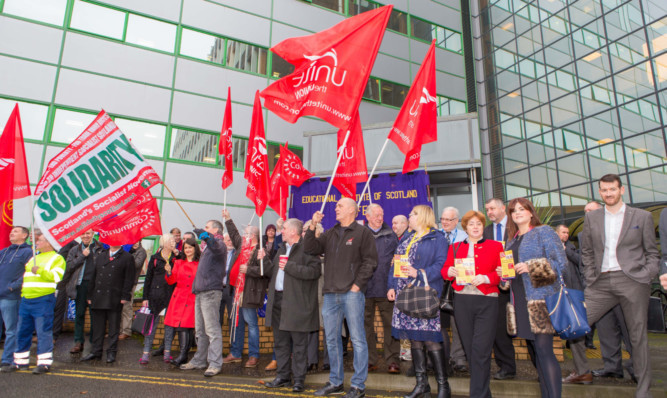 Protesters opposing the UK Governments Trade Union Bill outside the council meeting.