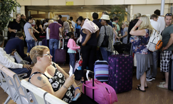 British tourists wait at the airport in Sharm el-Sheikh.