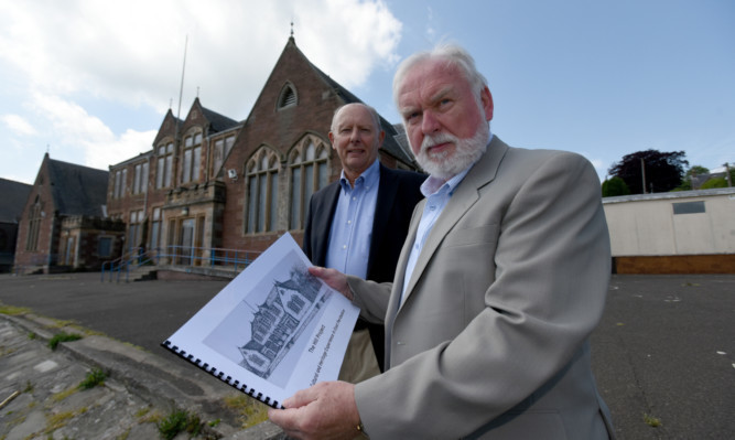 Mike Stevenson, left, a trustee of the Ericht Trust, and Ian Gordon, trust chairman, with a document outlining the groups proposal to buy the listed building.
