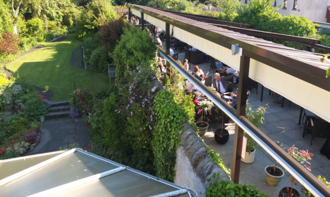The West Port Bar and Kitchen covered beer garden runs alongside a residential property.