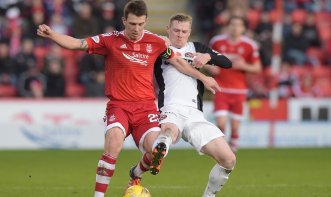 Aberdeen's Ryan Jack holds off United's Billy Mckay.