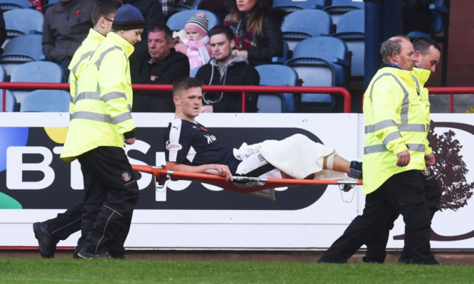 Rhys Healey is carried off injured.