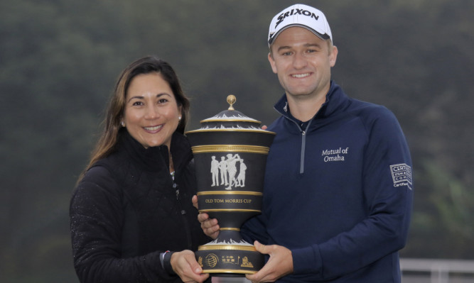 Russell Knox and wife Andrea with the HSBC Champions Trophy.