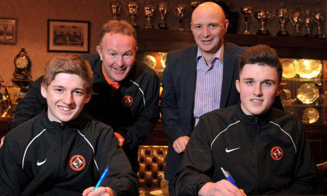Stevie Campbell (back left) was there with chairman Stephen Thompson to see young prospects Ryan Gauld (front left) and John Souttar sign full-time deals with Dundee United in 2013.