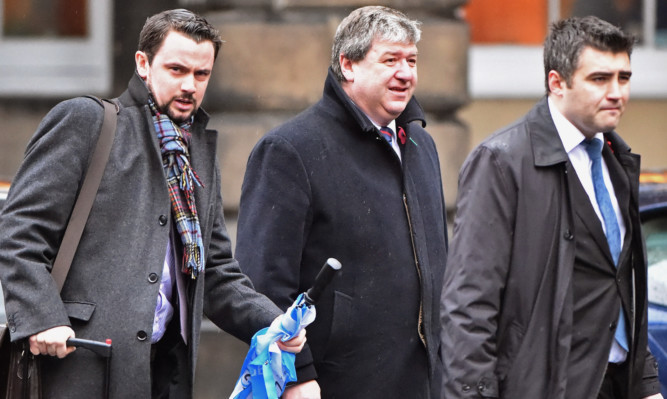 Alistair Carmichael (centre) at Edinburgh Court of Session where he is appearing over a falsified memo that was leaked when he was in charge at the Scotland Office.