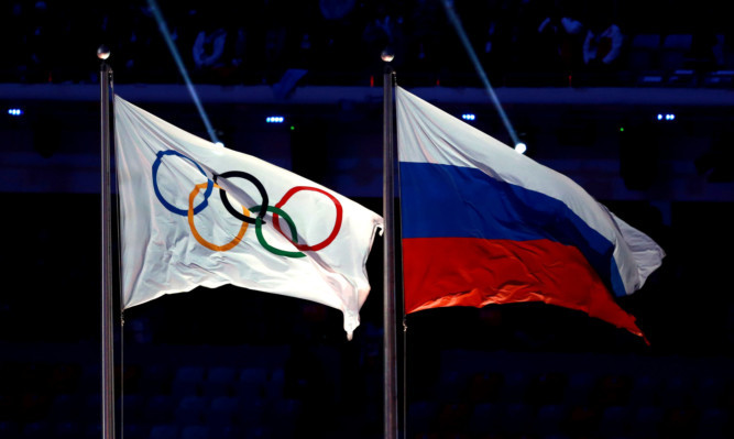 File photo dated 23-02-2014 of The Olympic flag flies next to the Russian flag during the Closing Ceremony at the Fisht Olympic Stadium, during the 2014 Sochi Olympic Games in Sochi, Russia. PRESS ASSOCIATION Photo. Issue date: (enter date here). See PA story (enter Topic Keyword). Photo credit should read David Davies/PA Wire.