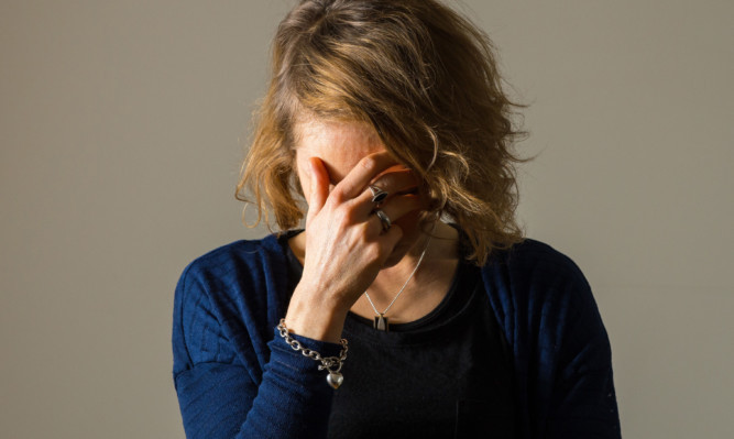 PICTURE POSED BY MODEL   Stock photo shows woman with depression. PRESS ASSOCIATION Photo. Picture date: Monday March 9, 2015. Photo credit should read: Dominic Lipinski/PA Wire