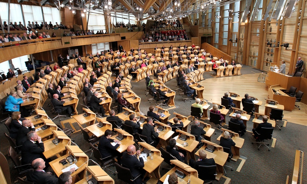 Newly elected MSP Tricia Marwick (far right) takes her position as the new Presiding Officer of the Scottish Parliament in Edinburgh as newly elected MSP's look on at a ceremony in the debating chamber.