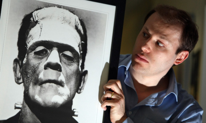 Dr Cook with a portait of the iconic monster.