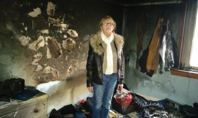 Marion Ferguson at the scene of her fire-ravaged house in Glencraig.