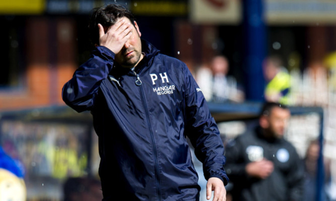 Bad day at the office? Dundee manager Paul Hartley looking dejected during a game with St Johnstone at Dens Park in April