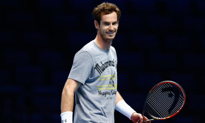 Andy Murray smiles in a practice session.