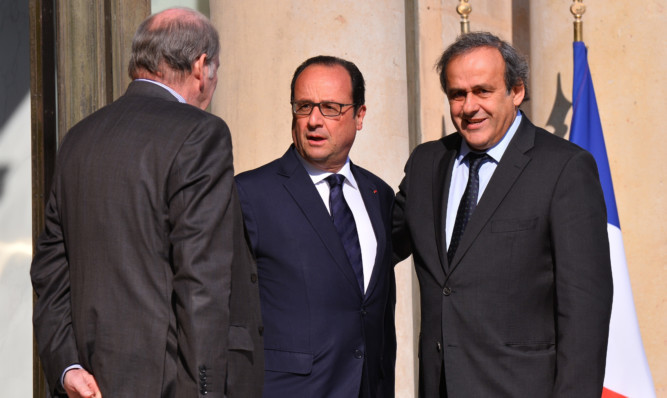From left: Jacques Lambert  with French President Francois Hollande and UEFA president Michel Plantini.