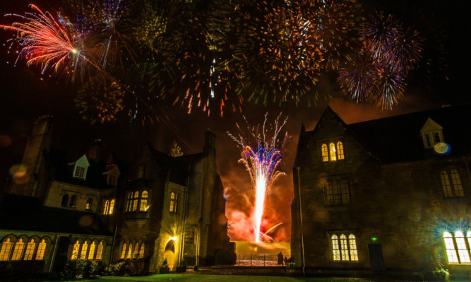 Pupils at Glenalmond College in Perthshire gather to celebrate taking part in what is thought to be the worlds first continuous global reunion in a 24 hour period.