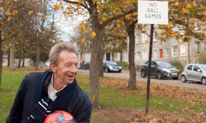 Denis Law in his home town of Aberdeen.