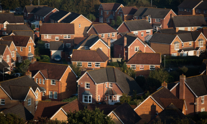 GLASTONBURY, ENGLAND - OCTOBER 01:  The sun rises over houses in a housing estate on October 1, 2015 in Glastonbury, England. The fine autumn weather that some parts of the UK have recently been experiencing is set to continue into October.  (Photo by Matt Cardy/Getty Images)