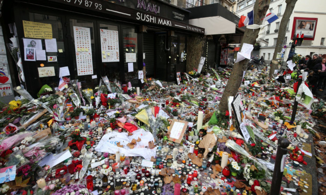 A sea of floral tributes left at the La Belle Equipe bar in Paris, which was one of the attack scenes.