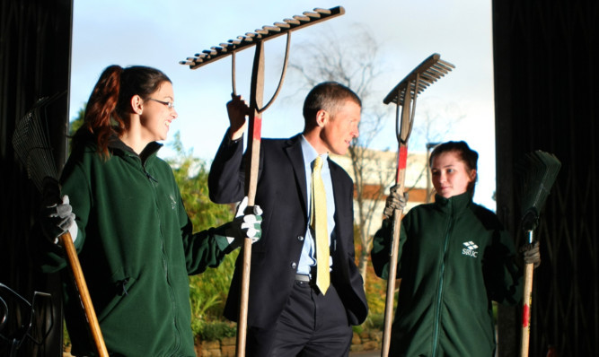 Scottish Liberal Democrat leader Willie Rennie with SVQ2 students Kimberley Barrass and Mia Weepers at the campus.