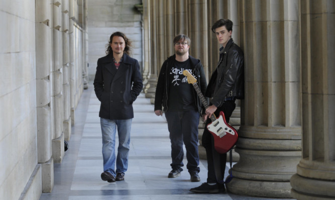 From left:  Mark Keiller and Kevin Black of  Fat Goth] and Jonny Jewel of Sam Gowans.