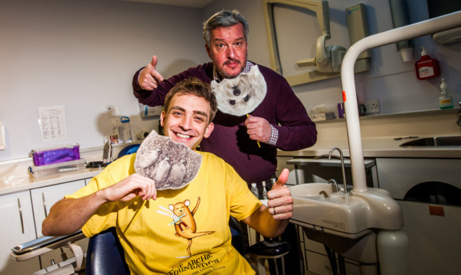 Steve MacDougall, Courier, Blairgowrie Dental Practice, High Street, Blairgowrie. Launch of Beards for Bairns 2016 for The ARCHIE. Pictured, left is dentist Neil Rutherford and right is local DJ Gary Robinson (correct).