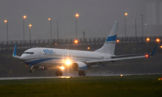 A flight from the Middle East arrives at Glasgow Airport carrying the first 100 Syrian refugees to be re-housed in Scotland.