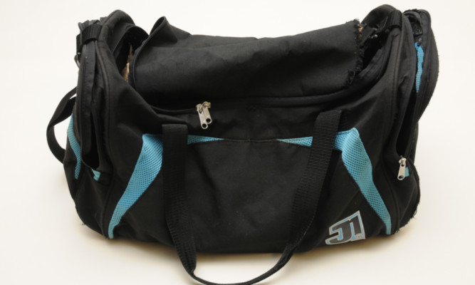 Police are asking for information on a distinctive black holdall that was used during the robbery.