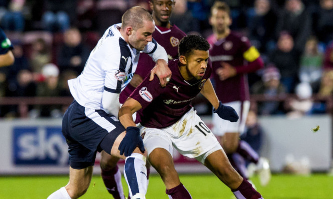 James McPake battles for the ball with Hearts' Osman Sow.