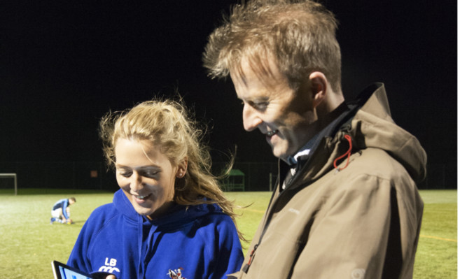 The Courier's Michael Alexander undergoes the King-Devick Test under the watchful eye of Howe of Fife Rugby Club physiotherapist Lianne Brunton