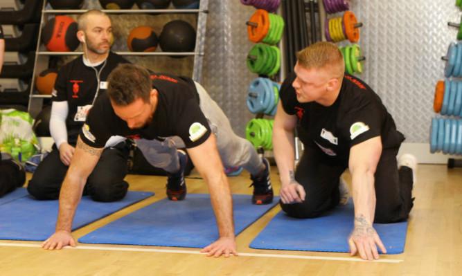 The men battle through the pain barrier.