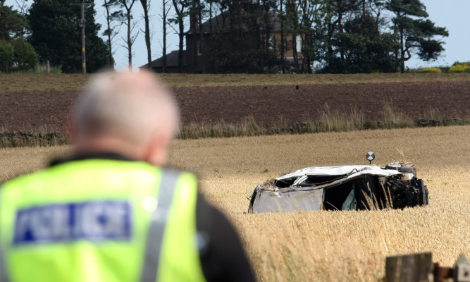 The aftermath of a fatal crash near Arbroath in August.