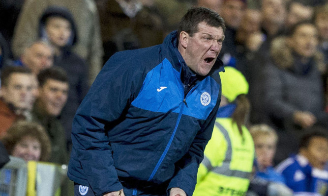 Tommy Wright making sure he gets 100% from his team at Tannadice.